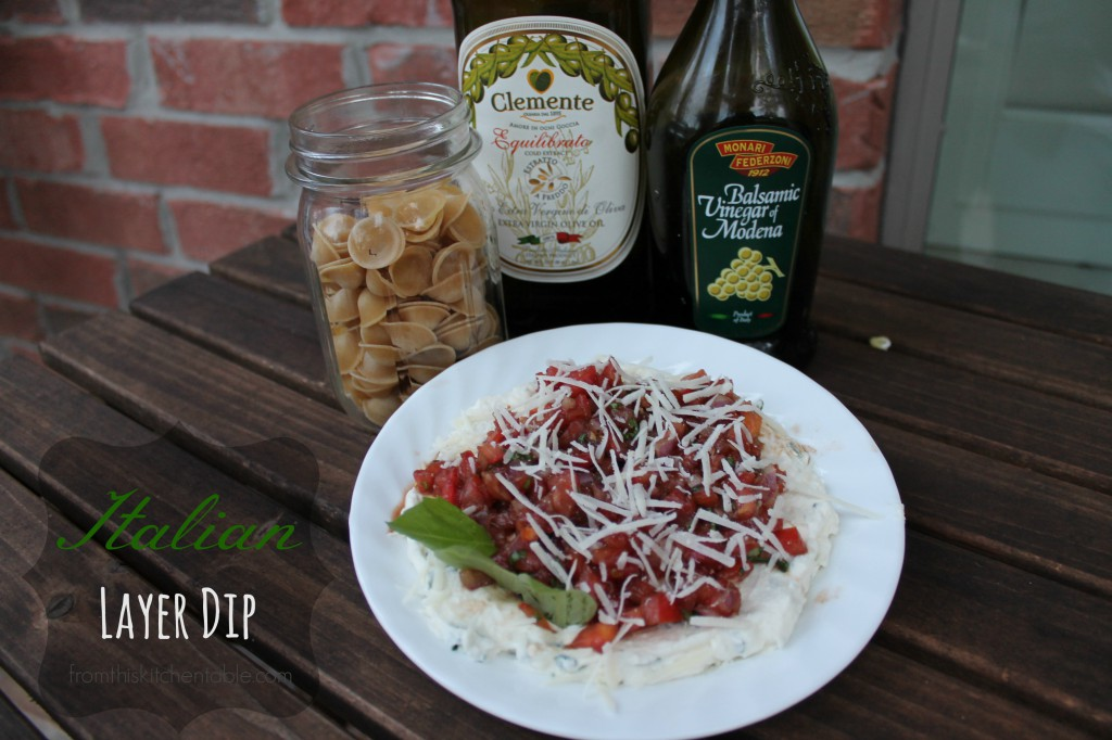 Italian Layer Dip. Yum! A creamy ricotta and cream cheese base topped with tomato, basil, olive oil, and balsamic. Refreshing and flavorful.