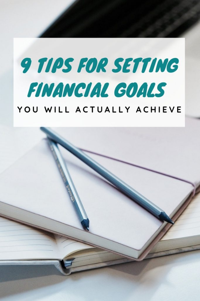 Pens and notebook with words on top for how to set financial goals