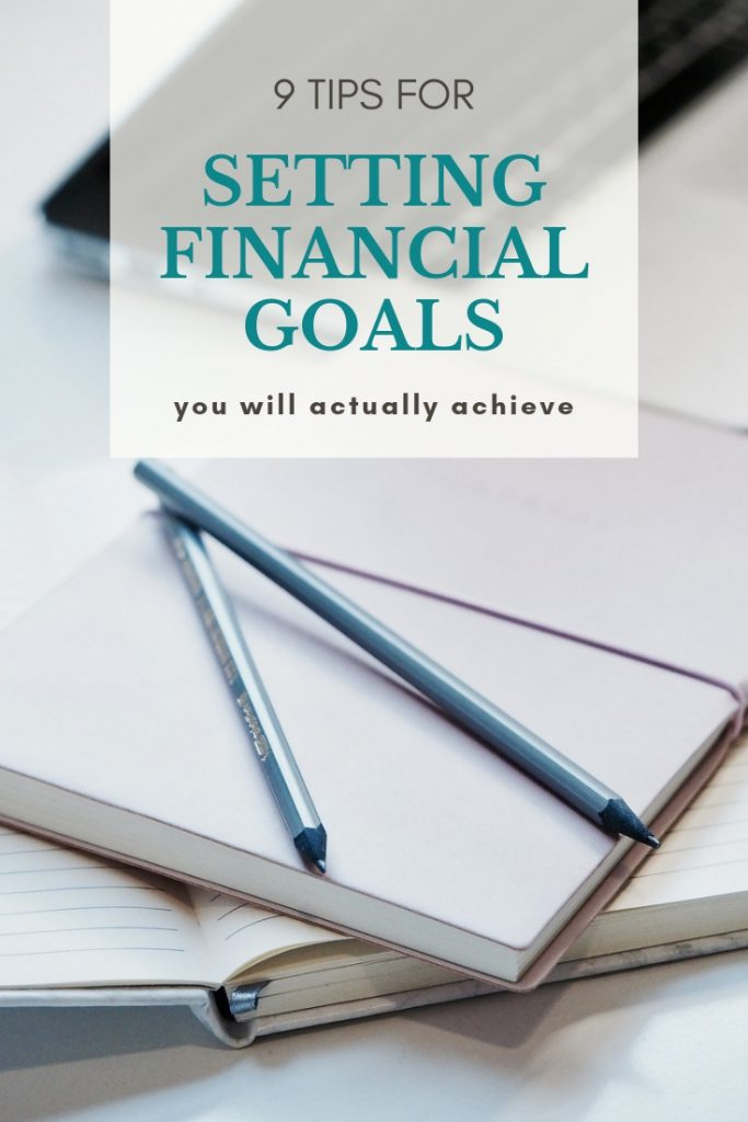 Notebook and pens laying on the table and words saying how to set financial goals