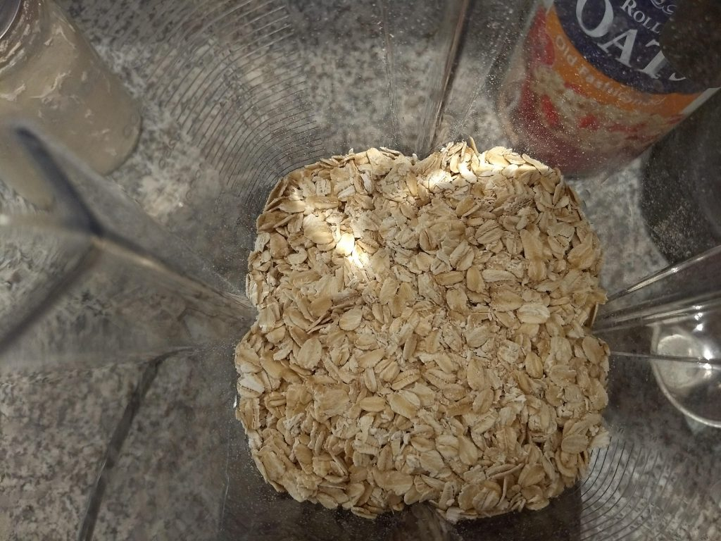 a blender with oats in it. If you've ever wondered how to make oat flour, this post will tell you how.
