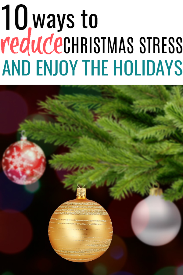 Christmas tree with ornaments. This year reduce the Christmas stress and actually ENJOY the holidays! These simple tips will transform your Christmas season.