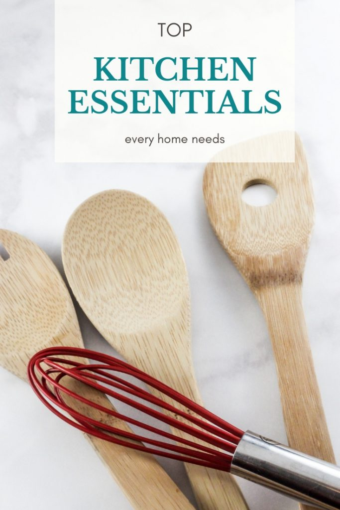 wooden spoons and a whisk on top of a towel for a list of must have kitchen items