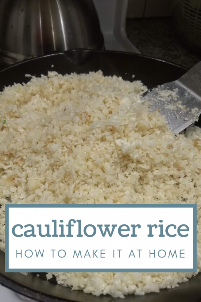Riced cauliflower cooking on a cast iron skillet