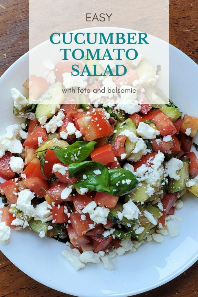 overhead shot of cucumber tomato salad with feta and balsamic in a bowl