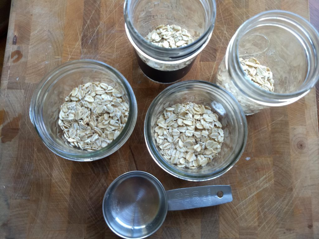 oats in the bottom of mason jars