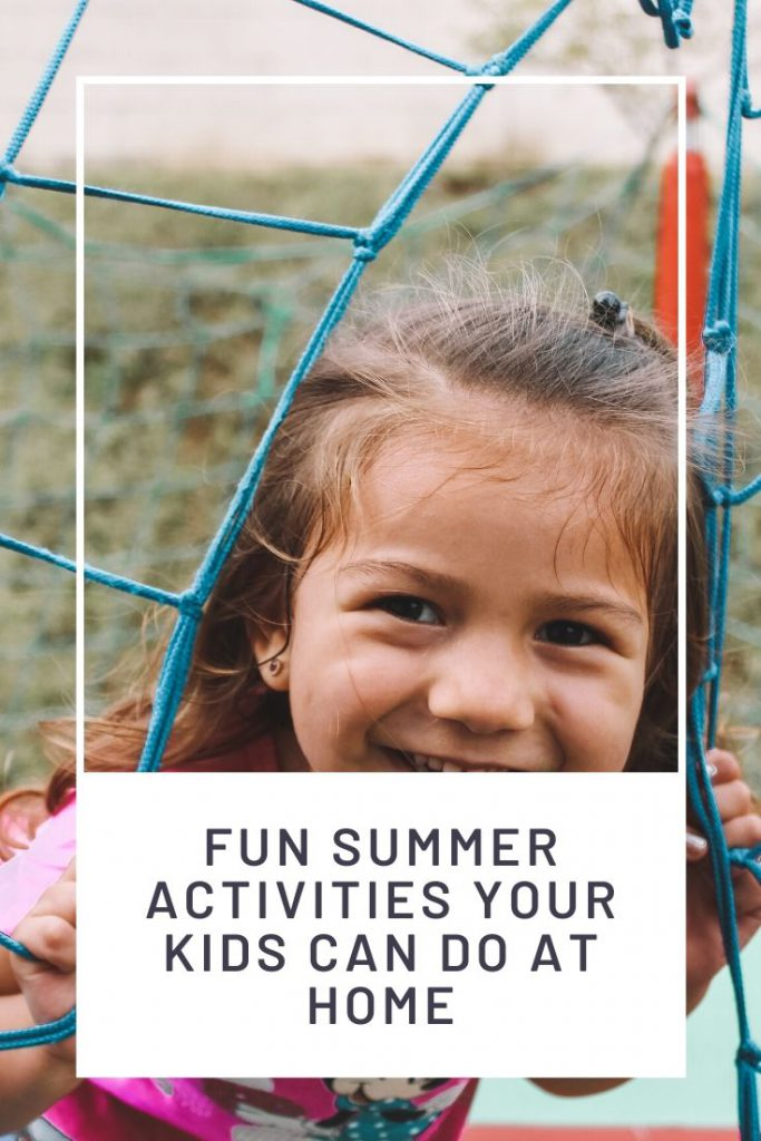 girl smiling outside and text summer activities for kids at home