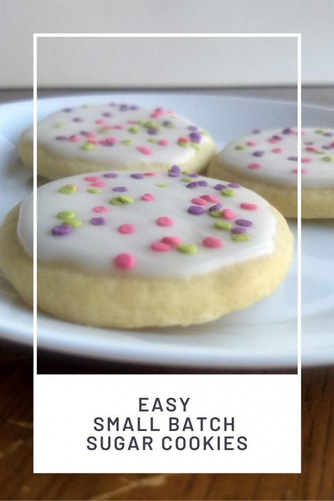 white frosted sprinkle sugar cookies on a plate