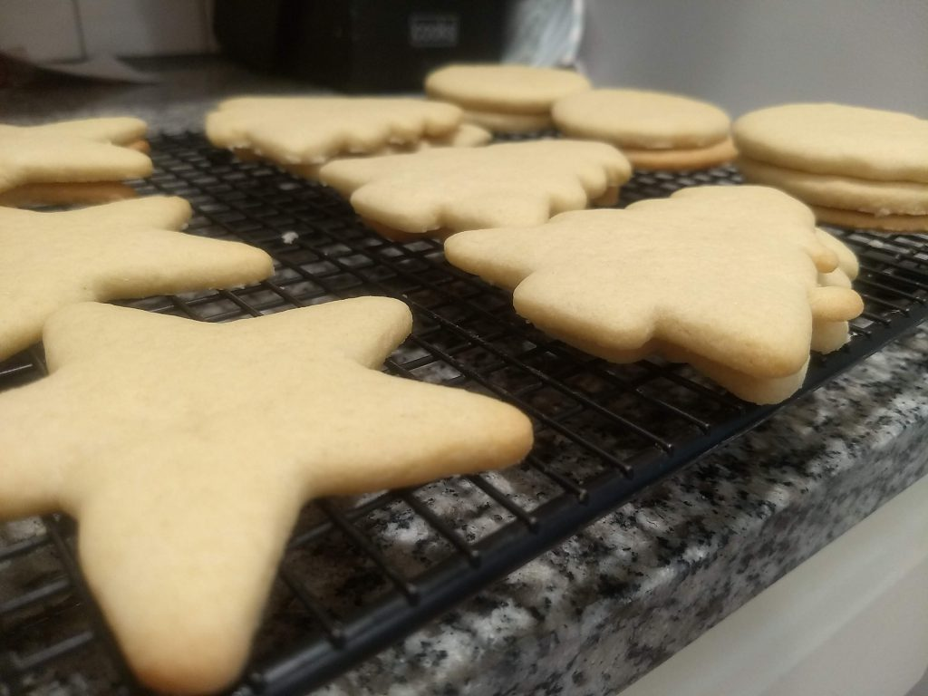 Baked sugar cookies on a cooling rack