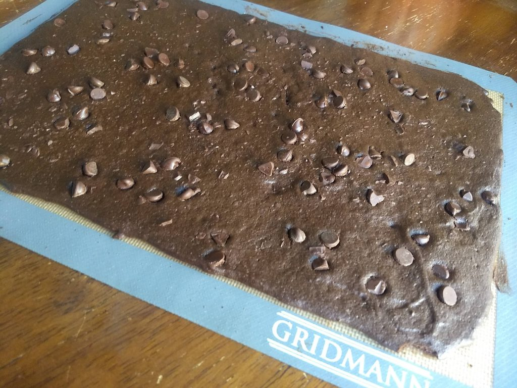 baked brownie brittle on a baking mat