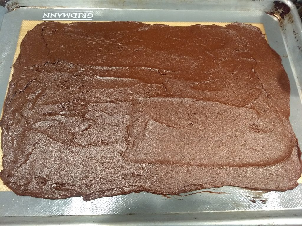 brownie brittle spread on silicone baking sheet