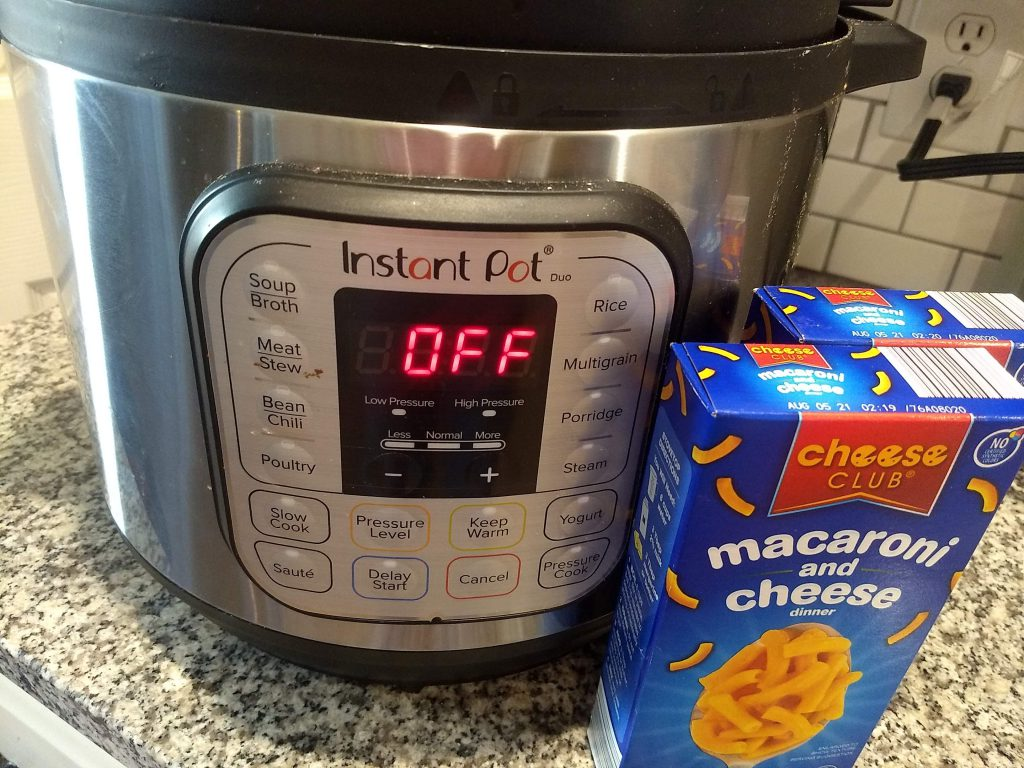 horizontal picture of 8 quart instant pot and boxed mac and cheese