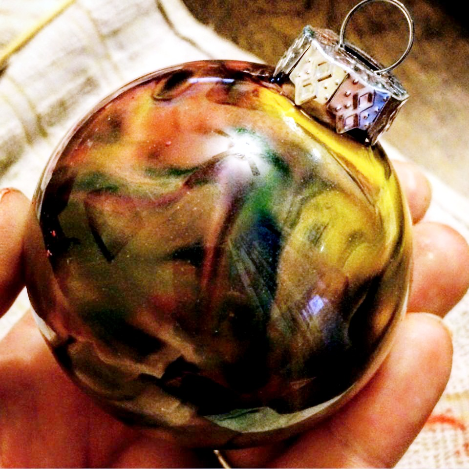 a green and yellow melted crayon ornament