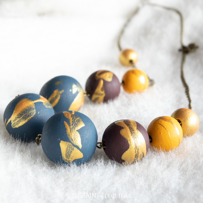 Blue and gold wooden beads on a necklace
