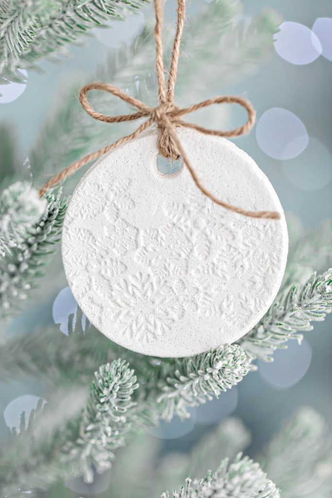 white salt dough ornament hanging on a tree