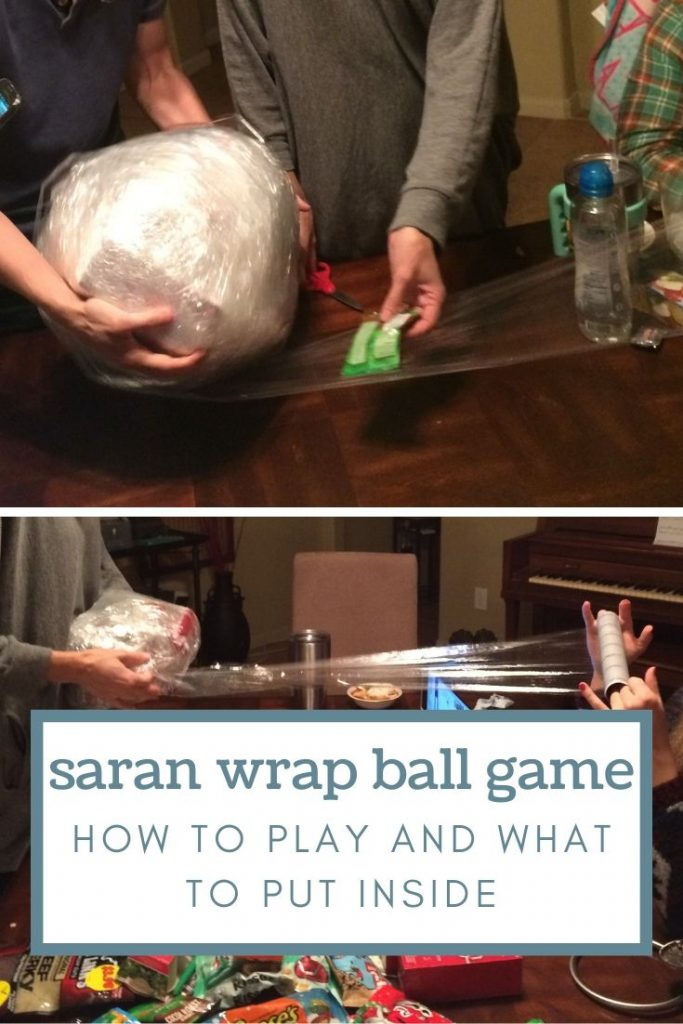 people wrapping the giant saran wrap ball and a table with gifts on it.
