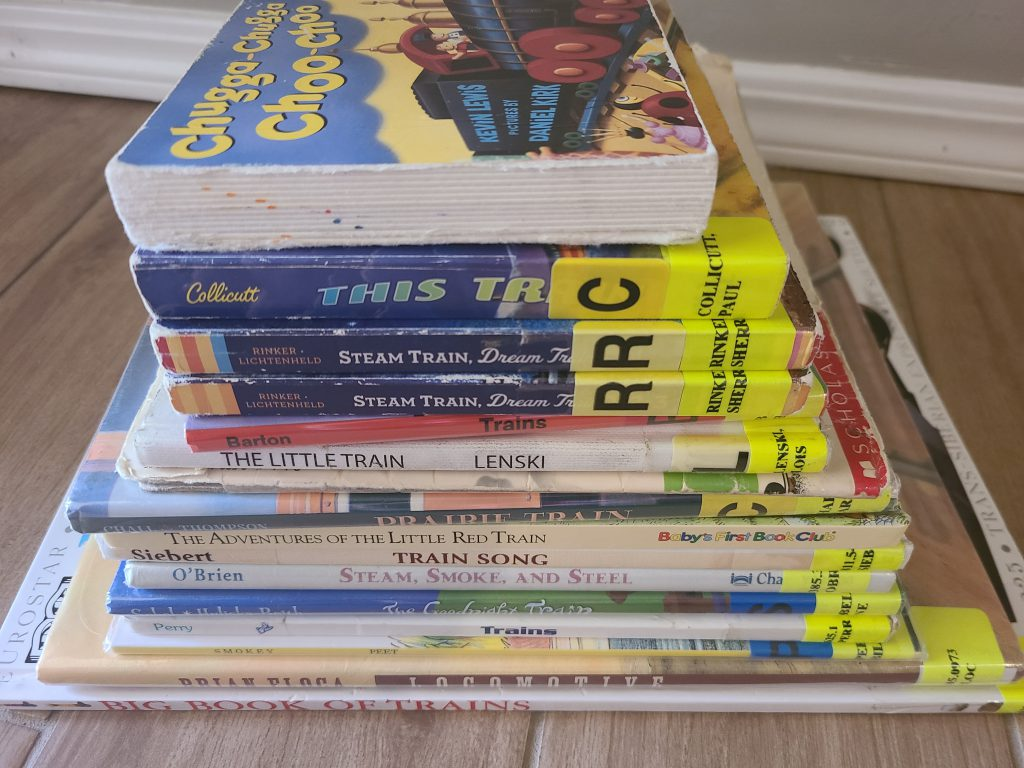 horizontal picture of books about trains for kids