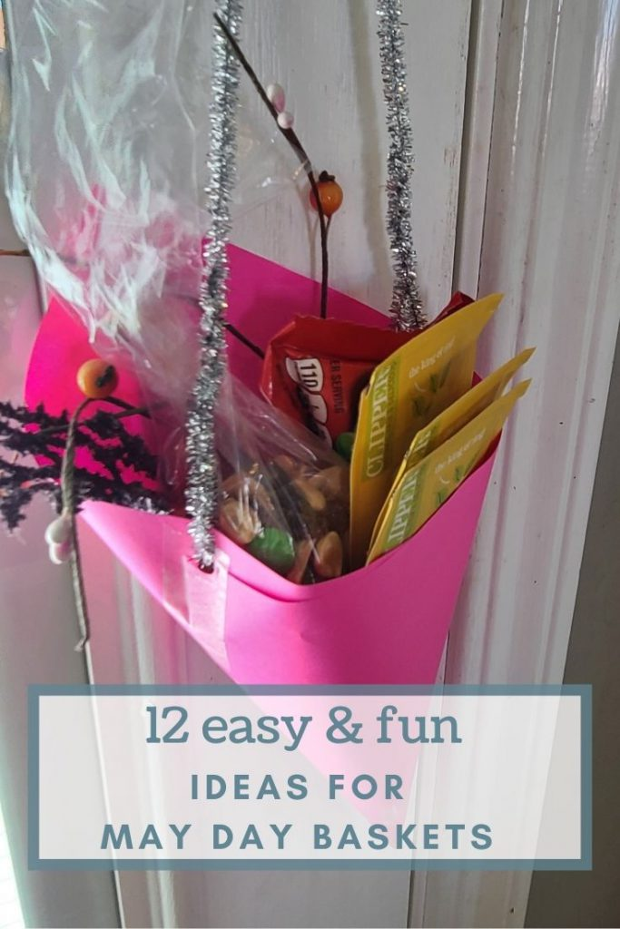 A homemade pink paper May Day Basket