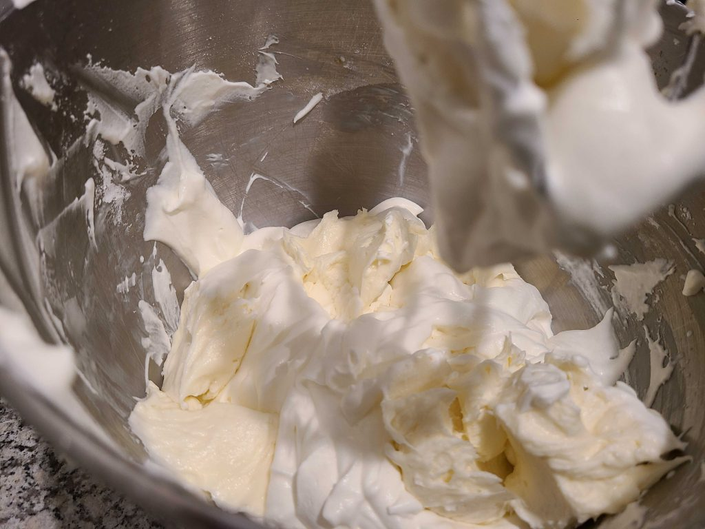 Cream cheese mixture dropped on top of the whipped cream