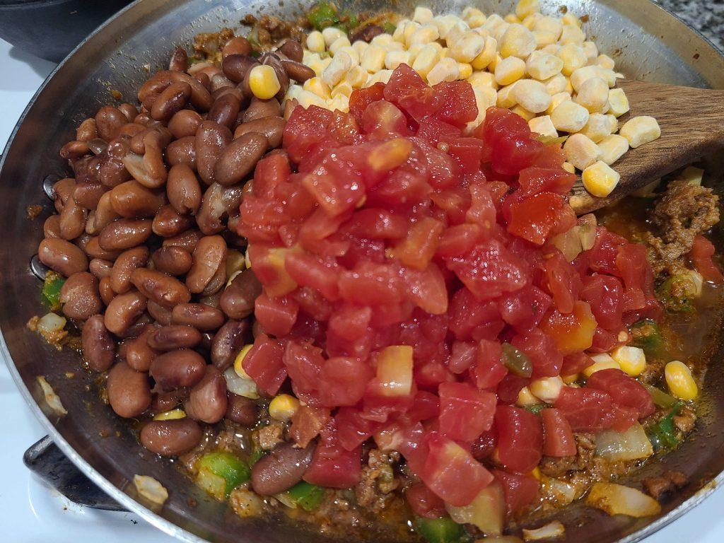 Taco pot pie ingredients in a pan